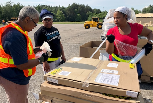 Members of DLA Distribution Depot Powidz, Poland, wrap a pallet of supplies destined for customers at a remote training for Saber Strike 2018. DLA is supporting the U.S. Army, Europe-led exercise taking place in Estonia, Latvia, Lithuania and Poland June 3-15. Photo by Nutan Chada