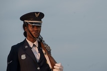 """A U.S. Air Force Ceremonial Guardsman prepares to present the colors during the Heritage to Horizons concert at the Air Force Memorial in Arlington, Va., June 8, 2018. The theme was """"You Are Not Forgotten,"""" paying tribute to those who fought, died and were captured or are still missing while defending American and America's freedoms. (Photo by Senior Master Sgt. Adrian Cadiz)"""