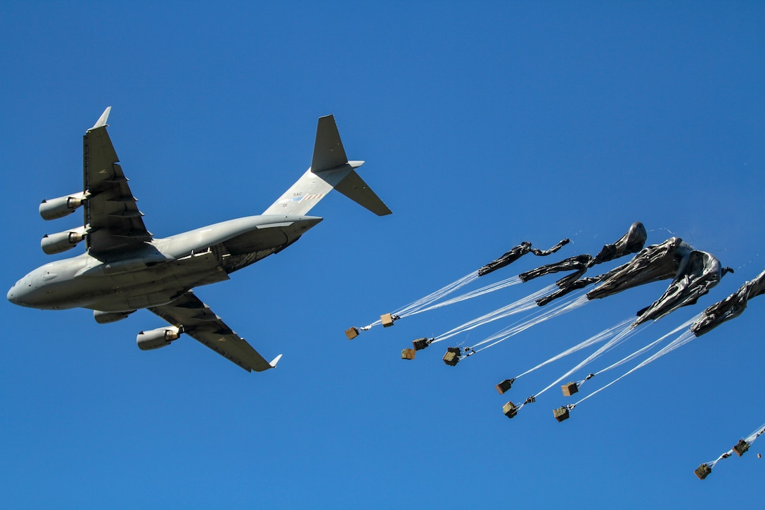 A Boeing C-17 Globemaster III drops equipment for the 173rd Airborne Brigade Combat Team during an airborne insertion exercise at Miroslawiec Air Base, Poland, June 8, 2018. The exercise is in support of Swift Response 18, a joint U.S. Army/Air Force exercise designed to train the U.S. Global Response Force - led by the U.S. Army's 82nd Airborne Division. (National Guard photo by Pvt. Chris Estrada)
