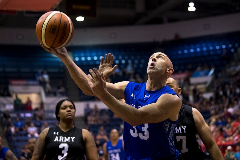 Team Air Force veteran Staff Sgt. Josh 'Smitty' Smith puts up a shot during the first half of the gold medal round in the 2018 Department of Defense Warrior Games wheelchair basketball competition at the Air Force Academy in Colorado Springs, Colo. June 9, 2018. (DoD photo by EJ Hersom)