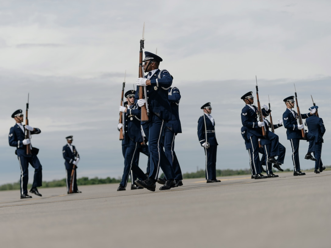 The U.S. Air Force Honor Guard Drill Team from Joint Base Anacostia-Bolling, Washington D.C., performs at the opening of the third day of the Thunder of Niagara 2018 air show at Niagara Falls Air Reserve Station, N.Y., June 10, 2018. The team remained flawless while the crowd was encouraged to make as much noise as possible while they performed. (U.S. Air National Guard photo by Staff Sgt. Ryan Campbell)