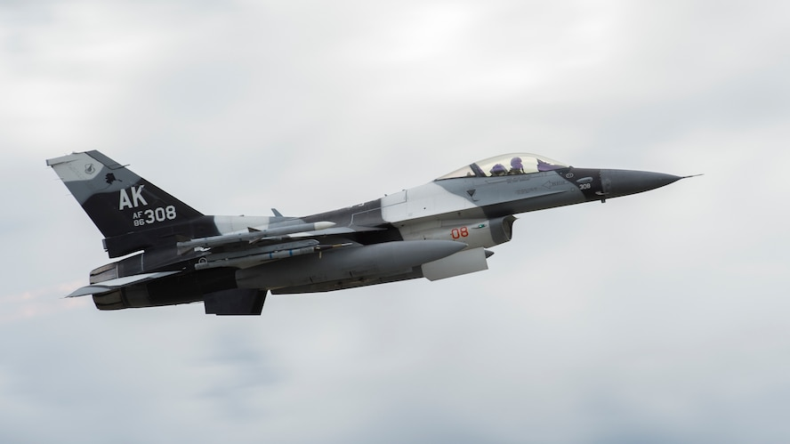 An F-16 Fighting Falcon belonging to the 18th Aggressor Squadron from Eielson Air Force Base, Alaska takes off as part of Red Flag Alaska, June 11, 2018. Red Flag Alaska is a simulated combat scenario comprised of multi-national forces. (U.S. Air National Guard photo by Airman 1st Class Mercedee Schwartz)