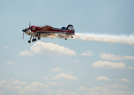 A Yak 110 aircraft flies in the clouds at the Gunfighter Skies Air and Space Celebration at Mountain Home Air Force Base, Idaho, June 3, 2018. This was the first time the aircraft was flown in an air show. The plane is a combination of two Yak 55's with dual cockpits and controls. (U.S. Air Force photo by Senior Airman Chester Mientkiewicz)