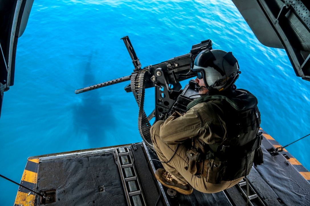 U.S. 5TH FLEET AREA OF OPERATIONS (June 13, 2018) U.S. Marine Corps Staff Sgt. Robert Lyvers, a CH-53E Super Stallion crew chief with Marine Medium Tiltrotor Squadron (VMM) 162 (Reinforced), 26th Marine Expeditionary Unit (MEU), prepares for landing aboard  the Wasp-class amphibious assault ship USS Iwo Jima (LHD 7) in the U.S. 5th fleet area of operations, June 13, 2018. The 26th MEU and IWO ARG are deployed to the U.S. 5th Fleet AO to support Maritime Security Operation to reassure partners and allies, preserve freedom of navigation, and freeflow of commerce. (U.S. Marine Corps photo by Gunnery Sgt. Eric L. Alabiso II/Released)