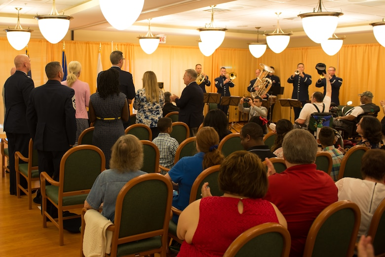 The Heartland of America Band's Offutt Brass plays the Air Force Song at a Memorial Day ceremony at the Eastern Nebraska Veterans' Home May 28, 2018, Bellevue, Nebraska. As part of the ceremony, current and former service members stood and sang when their respective service's song was played while the rest of the audience clapped along in support. (U.S. Air Force photo by Paul Shirk)