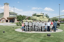 Airmen and family members from the 557th Weather Wing pose for a group photo in front of the Eastern Nebraska Veterans' Home May 28, 2018, Bellevue, Nebraska. The group volunteered to assist the ENVH in hosting their Memorial Day ceremony. (U.S. Air Force photo by Paul Shirk)