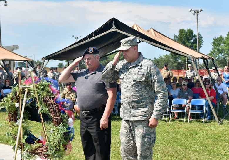 U.S. Air Force Brig. Gen. John Nichols, commander of the 509th Bomb Wing, and Roger Duvall, an Air Force veteran, salute a memorial wreath laid to honor the fallen Airmen of the Charlie Fire Team at Whiteman Air Force Base, Missouri, June 10, 2018