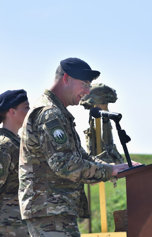 U.S. Air Force Lt. Col. Justin Secrest, 509th Security Forces Squadron commander, gives opening remarks during the Charlie Fire Team remembrance ceremony at Whiteman Air Force Base Missouri, June 10, 2018