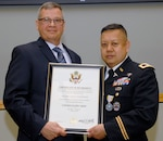 Army Col. Alex Zotomayor, Medical supply chain director, right, poses with Richard Ellis, DLA Troop Support deputy commander, left, during a retirement ceremony at DLA Troop Support in Philadelphia, June 13, 2018.