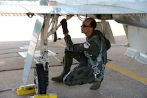 Maj. Thomas Collins, 43rd Flying Training Squadron instructor pilot, performs a preflight check on a T-38C Talon June 12, 2018, on Columbus Air Force Base, Mississippi. The 43rd IPs are embedded with each flying training squadron at Columbus AFB to help their active-duty counterparts produce more pilots. (U.S. Air Force photo by Airman 1st Class Beaux Hebert)