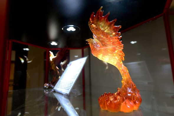 A decorative phoenix sits inside a display case in the 43rd Flying Training Squadron office June 12, 2018, on Columbus Air Force Base, Mississippi. The 43rd FTS, also known as the Firebirds, have been producing pilots at Columbus AFB since 1990. (U.S. Air Force photo by Airman 1st Class Beaux Hebert)
