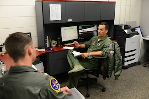 Maj. Dave Albertson, 43rd Flying Training Squadron, instructor pilot, teaches 2nd Lt. Christopher Newman, 14th Student Squadron student pilot, the fundamentals of flying a T-6A Texan II June 12, 2018, on Columbus Air Force
