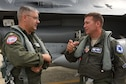 U.S. Coast Guard Capt. Eric Gleason, assigned to USCG Air Station Atlantic City, talks with Lt. Col. Andrew Thorne, 169th Fighter Wing, South Carolina Air National Guard, following an Aerospace Control Alert familiarization flight in an F-16 Fighting Falcon during the Southeast ACA Conference June 5. The 169th Fighter Wing, in close coordination with the Continental U.S. North American Aerospace Defense Command Region, the Eastern Air Defense Sector and the Federal Aviation Administration, hosted the Southeast Aerospace Control Alert Conference at McEntire Joint National Guard Base, S.C., June 5-7. The conference was a total-team training initiative to improve homeland defense capabilities by developing techniques with joint forces during small-scale exercises. This conference consisted of South Carolina Air National Guard 169th FW F-16 fighter jets, U.S. Coast Guard Rotary Wing Air Intercept Squadron MH-65D Dolphin helicopters from USCG Air Station Atlantic City and South Carolina Wing Civil Air Patrol aircraft and crews to hone their skills with tactical-level air-intercept procedures. (U.S. Air National Guard photo by Senior Master Sgt. Edward Snyder)