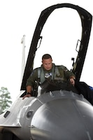 U.S. Air Force Maj. Justin Dumais, a pilot from the 169th Fighter Wing, enters the cockpit of his F-16C in preparation for an Aerospace Control Alert training mission, June 5, during the Southeast Aerospace Control Alert Conference at McEntire Joint National Guard Base, S.C. June 5-7. The 169th Fighter Wing hosted the conference in close coordination with the Continental U.S. North American Aerospace Defense Command Region, the Eastern Air Defense Sector and the Federal Aviation Administration. The conference was a total-team training initiative to improve homeland defense capabilities by developing techniques with joint forces during small-scale exercises. This conference consisted of South Carolina Air National Guard 169th FW F-16 fighter jets, U.S. Coast Guard Rotary Wing Air Intercept Squadron MH-65D Dolphin helicopters from USCG Air Station Atlantic City and South Carolina Wing Civil Air Patrol aircraft and crews to hone their skills with tactical-level air-intercept procedures. (U.S. Air National Guard photo by Senior Master Sgt. Edward Snyder)