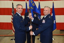 Maj. Gen. Stephen Whiting, 14th Air Force commander, hands the guide-on to Col. Scott Brodeur, 614th Air and Space Operations Center commander, during a change of command ceremony on June 8, 2018, at Vandenberg Air Force Base, Calif. Brodeur assumed command of the 614th AOC from Col. Michael Manor. (U.S. Air Force photo by Tech. Sgt. Jim Araos/Released)