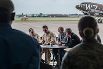 Pilots participating in a Heritage Flight hold a pre-flight briefing prior to takeoff on June 7, 2018, Niagara Falls International Airport, N.Y. The Air Force Heritage Flight Foundation provides dramatic flying displays to the entire world, pairing modern aircraft performances with fighter aircraft from the WWII, Korea and Vietnam eras. (U.S. Air Force photo by Master Sgt. Greg Steele/Released)