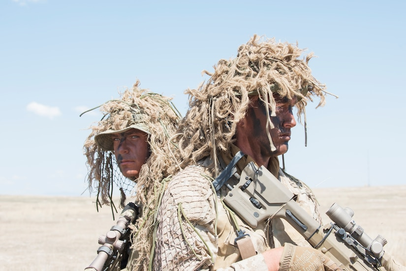 Two Idaho Army National Guard snipers conduct reconnaissance at the Orchard Combat Training Center, Boise, Idaho.