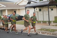 U.S. Marine Corps Lt. Col. Benjamin Harrison, commanding officer, 1st Battalion, 12th Marine Regiment (1st Bn. 12th Marines) and Sgt. Maj. Jose Romero, sergeant major, 1st Bn., 12th Marines lead the battalion's staff noncommissioned officers and officers during a morning run, Marine Corps Base Hawaii, June 14, 2018. Lt. Col. Harrison ran with the leadership of the battalion for the last time before he relinquishes his command on June 15, 2018. (U.S. Marine Corps photo by Sgt. Zachary Orr)