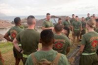 U.S. Marine Corps Lt. Col. Benjamin Harrison, commanding officer, 1st Battalion, 12th Marine Regiment, speaks to his battalion staff noncommissioned officers and officers prior to going to Range 10, Marine Corps Base Hawaii, June 14, 2018. Lt. Col. Harrison ran with the leadership of the battalion for the last time before he relinquishes his command on June 15, 2018. (U.S. Marine Corps photo by Sgt. Zachary Orr)