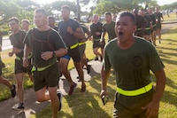 U.S. Marine Corps Sgt. Maj. Jose Romero, sergeant major, 1st Battalion, 12th Marine Regiment (1st Bn. 12th Marines), calls cadence during a morning run, Marine Corps Base Hawaii, June 14, 2018. Lt. Col. Benjamin Harrison, commanding officer, 1st Bn., 12th Marines, ran with the leadership of the battalion for the last time before he relinquishes his command on June 15, 2018. (U.S. Marine Corps photo by Sgt. Zachary Orr)