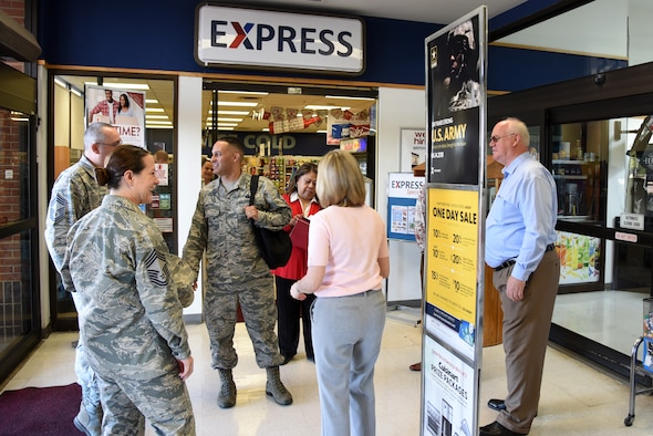 U.S. Air Force Chief Master Sgt. Luis Reyes, the Army & Air Force Exchange Service's senior enlisted advisor, meets with several Goodfellow personal and AAFES members outside of the Express minimart on Goodfellow Air Force Base, Texas, June 14, 2018. Reyes visited the base to learn more about Goodfellow's AAFES stores and restaurants. (U.S. Air Force photo by Staff Sgt. Joshua Edwards/Released)
