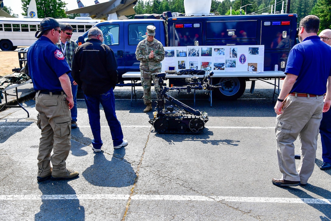 As part of the Employer Support of the Guard and Reserve (ESGR) Bosslift program, civilian employers talk with the Washington National Guard's 10th Civil Support Team about their specialzied equipment that is used to identify and assess suspected weapons of mass destruction hazards June 6, 2018.  (U.S. Air National Guard photo by Capt. Colette Muller)