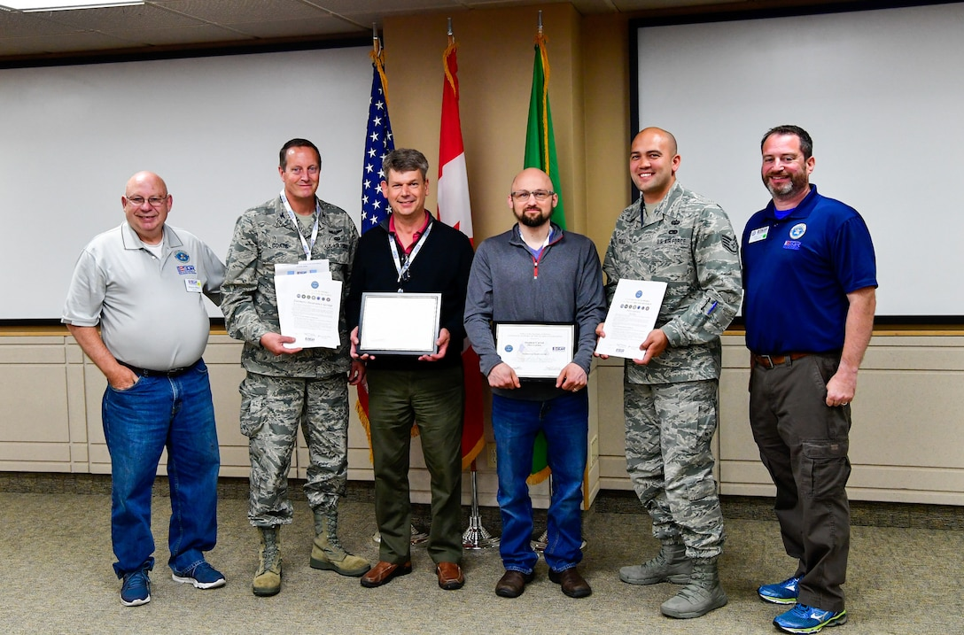 As part of the Employer Support of the Guard and Reserve (ESGR) Bosslift program, two civilian employers are recognized for their extraordinary support of their employees serving in the Guard.  Stephen Carroll, general manager for Olive Garden (third from right), was nominated by Staff Sgt. David Bauld, 225th Support Squadron, Western Air Defense Sector.  Mark Miller, managing attorney for Farmers Insurance Group (third from left), was nominated by Col. Jeffrey Coats, a military lawyer (JAG) with Headquarters Washington Air National Guard June 7, 2018.  (U.S. Air National Guard photo by Capt. Colette Muller)