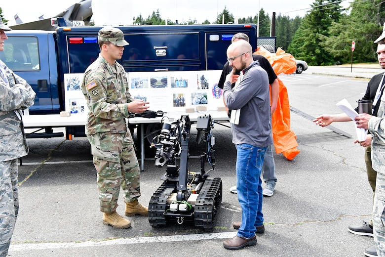 As part of the Employer Support of the Guard and Reserve (ESGR) Bosslift program, civilian employers talk with the Washington National Guard's 10th Civil Support Team about their specialized equipment that is used to identify and assess suspected weapons of mass destruction hazards June 7, 2018.  (U.S. Air National Guard photo by Capt. Colette Muller)