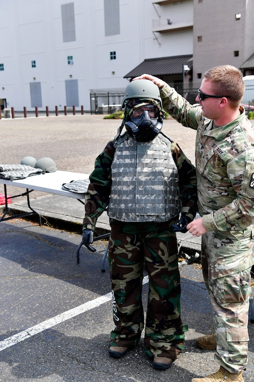 As part of the Employer Support of the Guard and Reserve (ESGR) Bosslift program, civilian employers suit up in mission oriented protective posture (MOPP) gear that is used during chemical, biological, radiological, or nuclear (CBRN) strike.  In addition, kevlar protective body armor and helmets are added over the MOPP gear June 7, 2018.  (U.S. Air National Guard photo by Capt. Colette Muller)