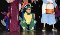 """Woodland character sings in production of """"Alice in Wonderland"""", June 15, 2018 at Altus Air Force Base, Okla."""