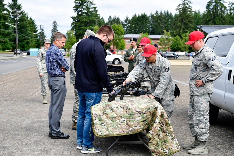 As part of the Employer Support of the Guard and Reserve (ESGR) Bosslift program, civilian employers  interact with the 627th Air Base Combat Arms Training and Maintenance personnel (CATM) June 7, 2018.  (U.S. Air National Guard photo by Capt. Colette Muller)