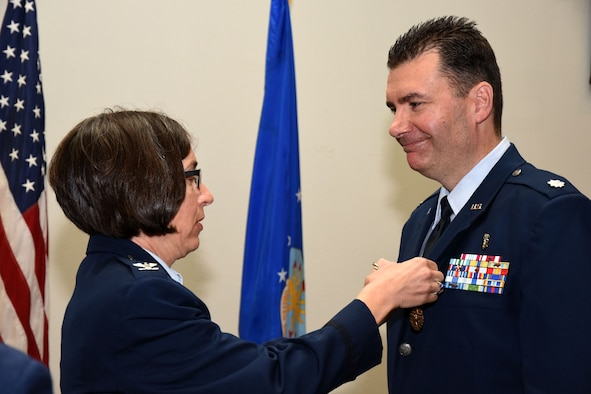 U.S. Air Force Col. Janet Urbanski, 17th Medical Group commander, pins the Meritorious Service Medal on Lt. Col. Achilles Hamilothoris, 17th Medical Support Squadron outgoing commander, during the 17th MDSS Change of Command at the Event Center on Goodfellow Air Force Base, Texas, June 15, 2018. Hamilothoris was the 17th MDSS commander for two years and revamped the dorm drug sweep program and built a new drug validation program, directly resulting in his unit being named wing unit of the year for 2016.  (U.S. Air Force photo by Airman 1st Class Seraiah Hines/Released)