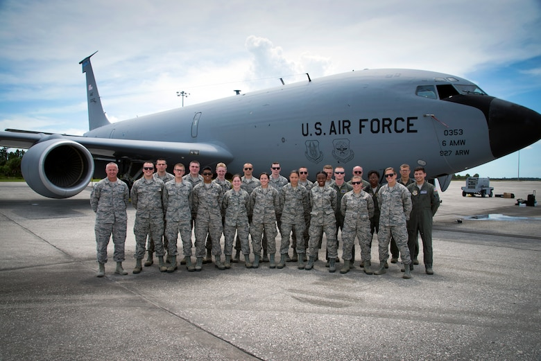 U.S. Air Force Reserve Officer Training Corps (ROTC) cadets pause for a photo with Chief Master Sgt. Michael Lemond, the superintendent assigned to the 6th Mission Support Group, along with KC-135 Stratotanker aircrew at MacDill Air Force Base, Fla., June 14, 2018.