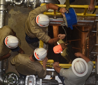 Employees at Old Hickory Hydropower Plant take part in a simulated exercise to extract a training dummy from a confined space during a Confined Space and Confined Space Rescue Course June 14, 2018 in Hendersonville, Tenn. The U.S. Army Corps of Engineers Nashville District trained 32 employees to lead the in-house training in March 2017, which will benefit more than 200 employees across the district who require the annual training. (USACE photo by Lee Roberts)