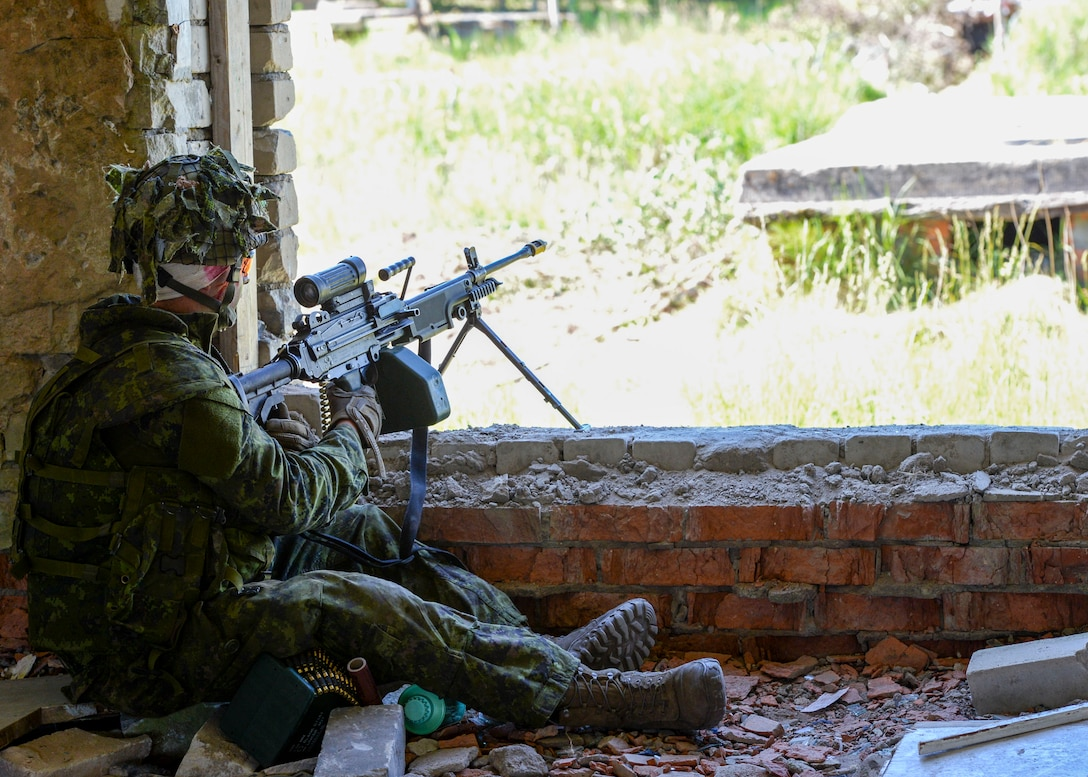 A member of the Canadian military waits for opposing forces to move during an exercise in Skrunda, Latvia on June 13, 2018. Canadian forces were teamed with Spanish, Italian, and Latvian platoons to act as a defending force during a battle simulation for Saber Strike 18. One of Saber Strike's major focuses is to build strong and strategic partnerships. (U.S. Air Force photo by Staff Sgt. Jimmie D. Pike)