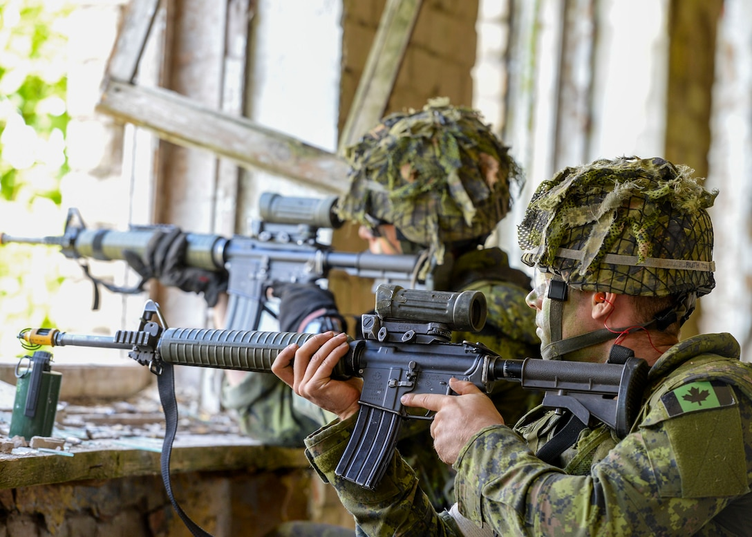 Members of a Canadian Platoon fire at opposing forces during an exercise in Skrunda, Latvia on June 13, 2018. Canadian forces were teamed with Spanish, Italian, and Latvian platoons to act as a defending force during a battle simulation for Saber Strike 18. Saber Strike included approximately 18,000 participants from 19 countries to continue building on interoperability. (U.S. Air Force photo by Staff Sgt. Jimmie D. Pike)