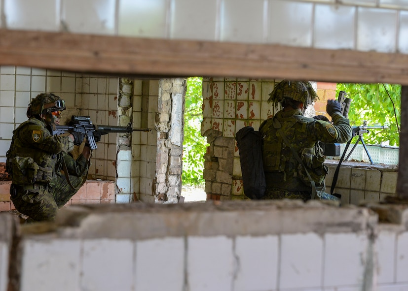 Members of a simulated defense force defend their post during an exercise in Skrunda, Latvia on June 13, 2018. The exercise was a part of Saber Strike 18 and featured a defending force comprised of Spanish, Italian, Canadian and Latvian Platoons; and an attacking force comprised of U.S. Marines, United Kingdom Royal Marines, Michigan Army National Guard, and Norwegian Forces. Saber Strike 18 is the eighth iteration of the long-standing U.S. Army Europe-led cooperative training exercise enhancing interoperability among allies and regional partners.  (U.S. Air Force photo by Staff Sgt. Jimmie D. Pike)