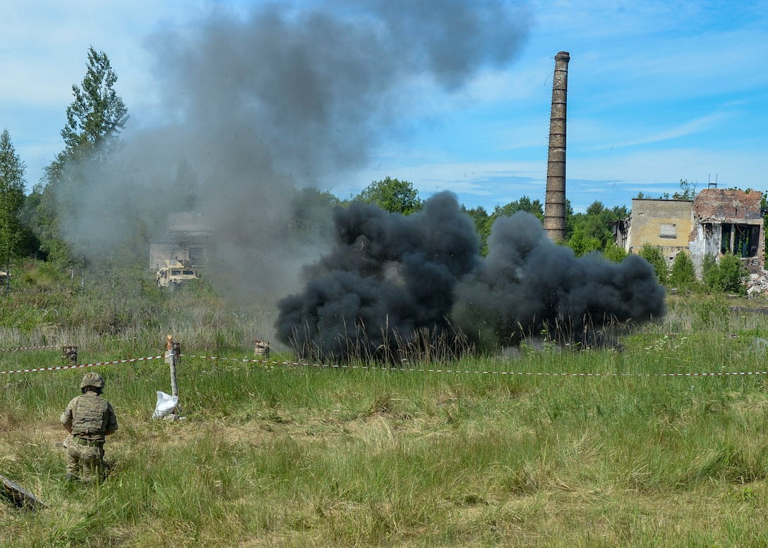 Explosive charges detonate on a simulated battlefield during a large scale battle scenario in Skrunda, Latvia on June 13, 2018. The scenario was a part of Saber Strike 18 and featured a defending force comprised of Spanish, Italian, Canadian and Latvian Platoons; and an attacking force comprised of U.S. Marines, United Kingdom Royal Marines, Michigan Army National Guard, and Norwegian Forces. (U.S. Air Force photo by Staff Sgt. Jimmie D. Pike)