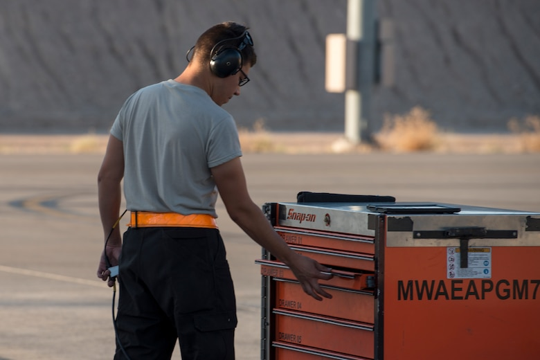 An image of Airman 1st Class Connor Badton, 3911st Fighter Squadron assistant dedicated crew chief, closes a toolbox during Green Flag West, June 13, 2018, at Nellis Air Force Base, Nevada. The 391st FS participated in Green Flag to further enhance readiness by training on Close Air Support over the National Training Center, Fort Irwin, California. (U.S. Air Force Photo by Airman 1st Class JaNae Capuno)