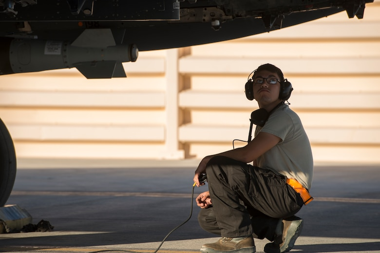 An image of Airman 1st Class Connor Badton, 3911st Fighter Squadron assistant dedicated crew chief, inspects an F-15E Strike Eagle during Green Flag West, June 13, 2018, at Nellis Air Force Base, Nevada. The 391st FS participated in Green Flag to further enhance readiness by training on Close Air Support over the National Training Center, Fort Irwin, California. (U.S. Air Force Photo by Airman 1st Class JaNae Capuno)
