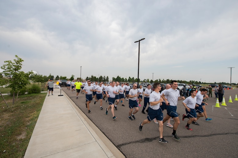 Members of the 460th Space Communication Squadron participate in a memorial run for Senior Airman Michael S. Snyder June 14, 2018, on Buckley Air Force Base, Colorado. Each year, Team Buckley members gather for the Snyder Ride and 5k run, which is a remembrance to honor Snyder, who was killed on his motorcycle in 2014 by a drunken driver. (U.S. Air Force photo by Senior Airman Stephen G. Eigel)