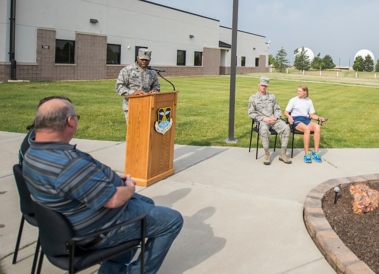Lt. Col. Erick Welcome, 460th Space Communication Squadron commander, speaks at a memorial run and ride for Senior Airman Michael S. Snyder June 14, 2018, on Buckley Air Force Base, Colorado. Each year, Team Buckley members gather for the Snyder memorial, which is a remembrance to honor Snyder, who was killed on his motorcycle in 2014 by a drunken driver. (U.S. Air Force photo by Senior Airman Stephen G. Eigel)