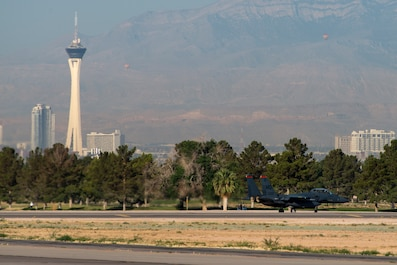 An image of an 391st Fighter Squadron F-15E Strike Eagle taxies to the runway during Green Flag West, June 13, 2018, at Nellis Air Force Base, Nevada. The 391st FS participated in Green Flag to further enhance readiness by training on Close Air Support over the National Training Center, Fort Irwin, California. (U.S. Air Force Photo by Airman 1st Class JaNae Capuno)