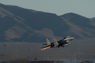 An image of a 391st Fighter Squadron F-15E Strike Eagle takes off during Green Flag West, June 13, 2018, at Nellis Air Force Base, Nevada. The 391st FS participated in Green Flag to further enhance readiness by training on Close Air Support over the National Training Center, Fort Irwin, California. (U.S. Air Force Photo by Airman 1st Class JaNae Capuno)