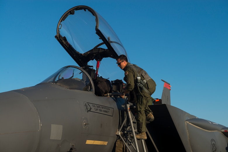 Image of Capt. Jesse Loya, 391st Fighter Squadron pilot, steps into an F-15E Strike Eagle during Green Flag West, June 13, 2018, at Nellis Air Force Base, Nevada. The 391st FS participated in Green Flag to further enhance readiness by training on Close Air Support over the National Training Center, Fort Irwin, California. (U.S. Air Force Photo by Airman 1st Class JaNae Capuno)