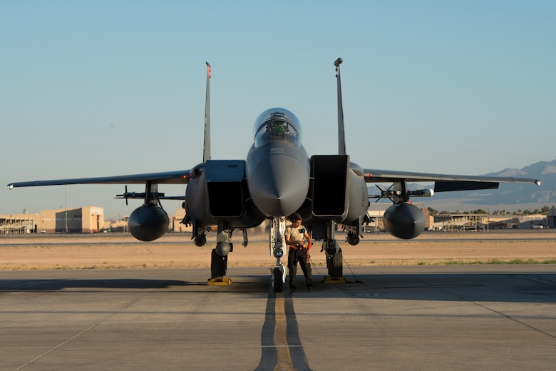 Image of Airman 1st Class Connor Badton, 3911st Fighter Squadron assistant dedicated crew chief, performs a pre-flight inspection during Green Flag West, June 13, 2018, at Nellis Air Force Base, Nevada. The 391st FS participated in Green Flag to further enhance readiness by training on Close Air Support over the National Training Center, Fort Irwin, California. (U.S. Air Force Photo by Airman 1st Class JaNae Capuno)