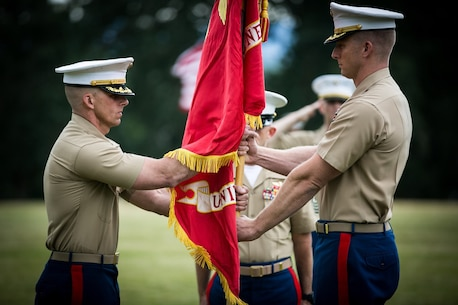 U.S. Marine Corps Maj. Brooks W. Boehlert (right) relinquishes command of Marine Corps Recruiting Station Portland to Maj. Mark M. Goebel during a change of command ceremony aboard Fort Vancouver, Wa., June 15, 2018. The change of command ceremony represents the changing of authority between outgoing Maj. Boehlert and the incoming Maj. Goebel. (U.S. Marine Corps imagery by Sgt. Travis Gershaneck/Released)