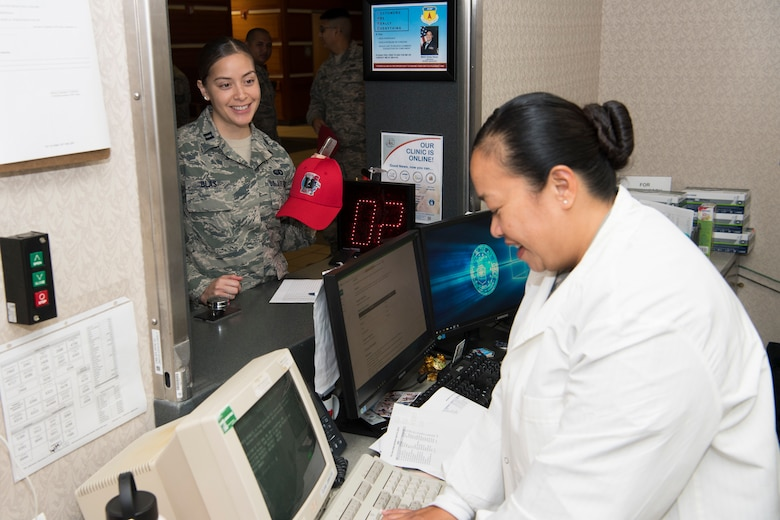 U.S. Air Force Capt. Jessica Blas, Air National Guard's 254th Red Horse Squadron personnel officer, checks in at the medical laboratory with Tech. Sgt. Jean Arroyo, Air Force Reserve's 624th Aerospace Medicine Flight medical laboratory non-commissioned officer in charge, to complete individual medical readiness requirements during a unit training assembly at Andersen Air Force Base, Guam, June 3, 2018.