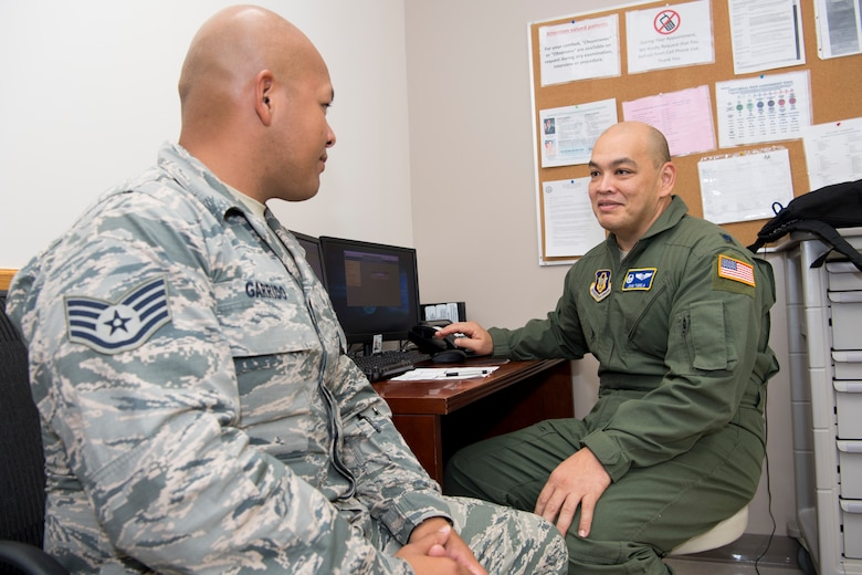 U.S. Air Force Lt. Col. John Tudela, Air Force Reserve's 624th Aerospace Medicine Flight commander and flight surgeon, talks with Staff Sgt. Roby Garrido, Air National Guard's 254th Red Horse Squadron management and analysis journeyman, as part of individual medical readiness requirements during a unit training assembly at Andersen Air Force Base, Guam, June 3, 2018.