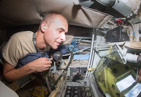U.S. Air Force Cadet Lt. Col. Matthew Entner, a student of Detachment 643 at Cedarville University in Ohio, experiences what it feels like to be in the boom operator bod during a KC-135 Stratotanker aircraft refueling flight June 14, 2018 over the Eastern United States.